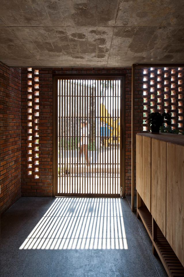 Sunny doorway a creative brick house controls the interior climate and looks amazing