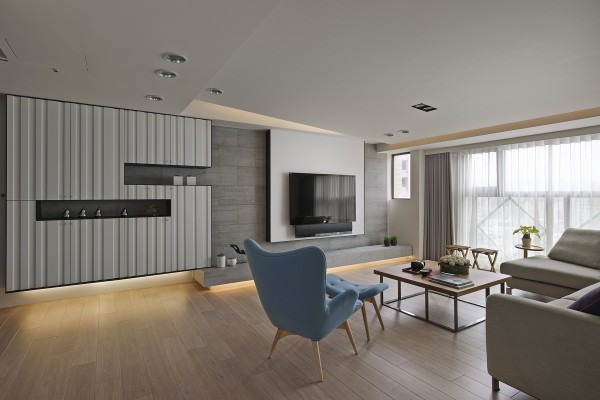 The living area asserts its charm with smart but sculptural storage along the main wall