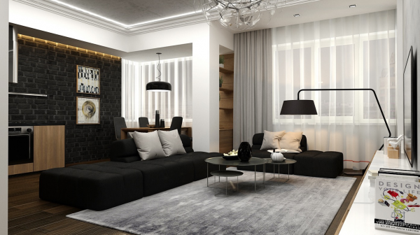 This black and white living room has a sleek, artistic bent to it. A perfect setting for a martini or two.