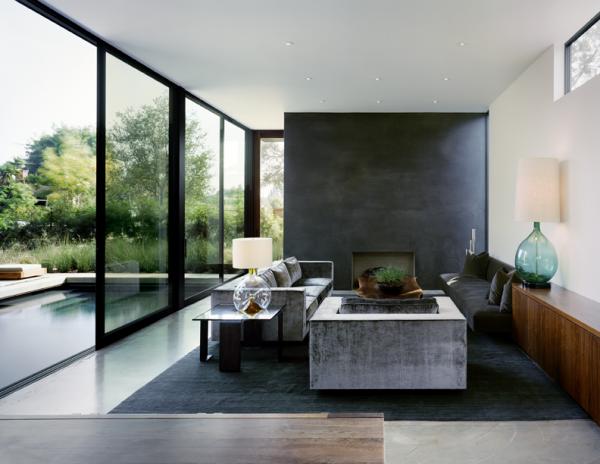 Việc sử dụng bê tông và gỗ biến phòng khách hiện đại này thành một minh chứng cho thiết kế giữa thế kỷ.