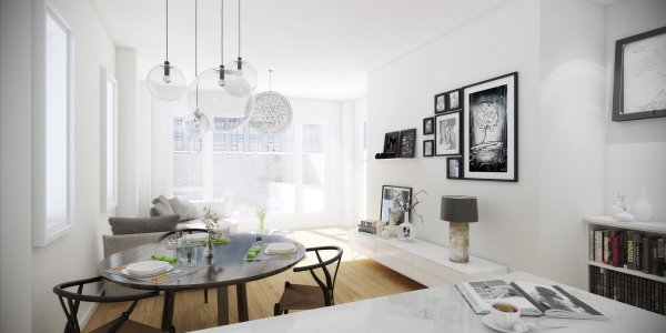 In this smaller living room, the white color scheme makes things feel more open.
