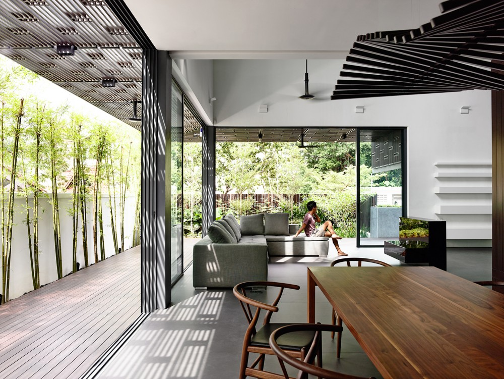 Open tropical home with interior courtyard and wood features
