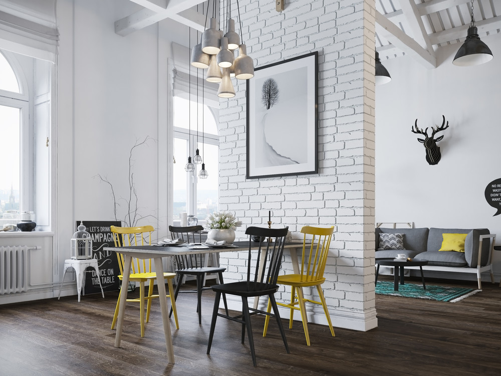 This particular loft does not shy away from design trends either a few pops of neon yellow create a playful contrast with chevron stripes