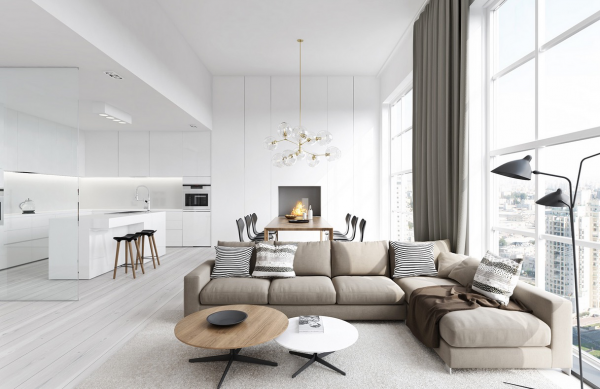 With an open floor plan, the slightest color shift can mean everything. Here, a beige sofa distinguishes the living area from its stark, white surroundings.