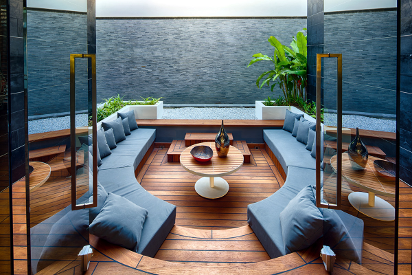 This teak wood living room is perfect for a living room that doubles as an outdoor entertaining space.