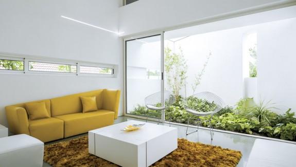 A Wild Modern Endangering Exterior Contains a Clean Modern Interior
