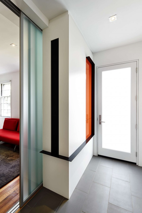 Pop of orange a bright modern row house redone for a fun couple with