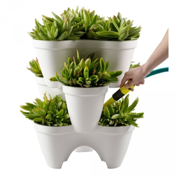 A tiered planter like this one saves space protects plants with a watering reservoir buy it