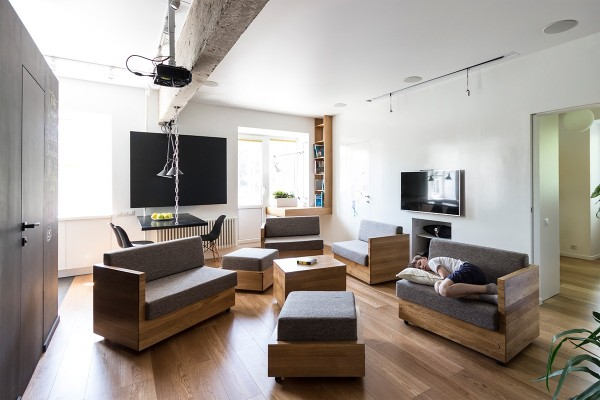 By scattering the little sofas and ottomans the room can accommodate small groups for socialization