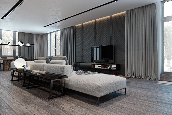 Low profile sofa and table are arranged above a dark rug its somewhat off center placement making the space feel a little more open and less rigid