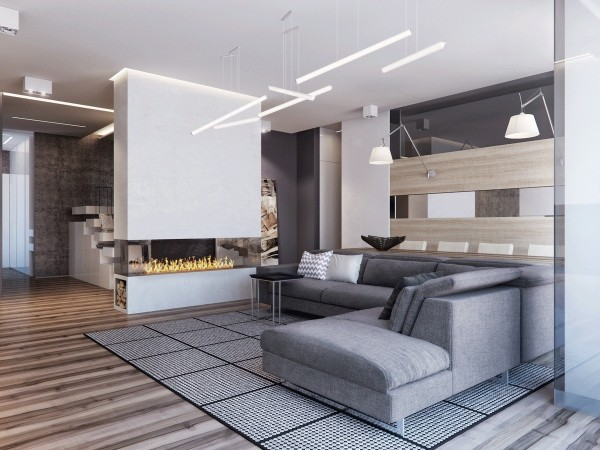 A freestanding faux fireplace marks the transition from the main living area to the private areas of the home the wood storage niche underneath enhances