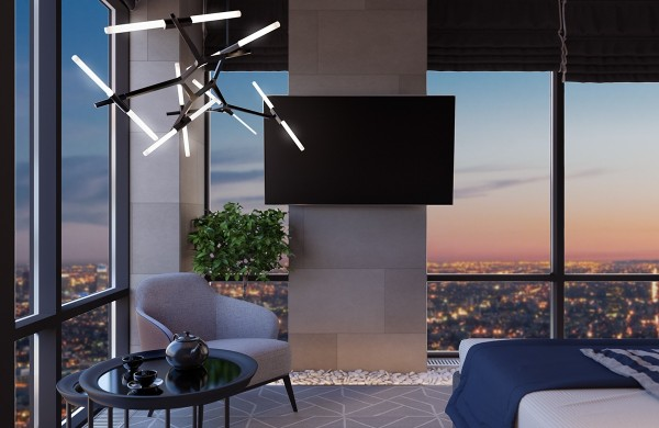 On the other side of the room materials take on a more subdued role to help direct attention toward the chandelier and the spectacular skyline behind it