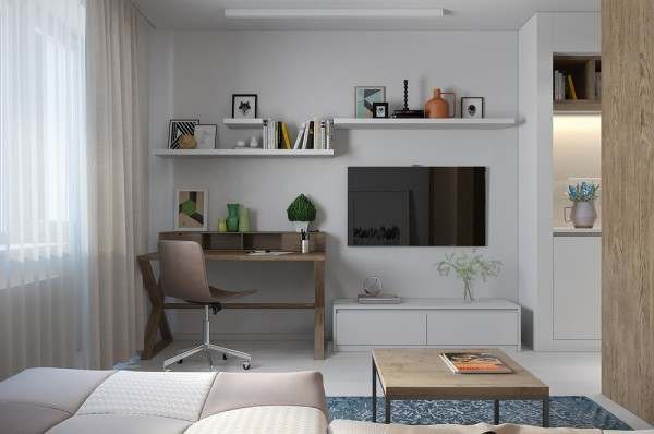 A neat and tidy office takes its place right next to the television open shelving houses useful books and offers a convenient way to display artwork