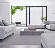 Concrete accents and sharp lines would make any other space feel too sterile, but the subtle range of grays does a wonderful job of softening the aesthetic.