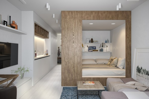 The bedroom occupies a central volume clad with wood veneer a natural focal point in the middle of an all white interior the only colorful accents include
