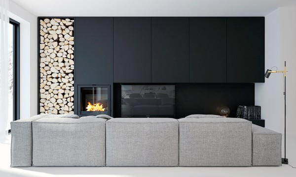 This massive fireplace made of dark wood is the perfect pop for the white and the cool undertones compliment the rest of the space wonderfully