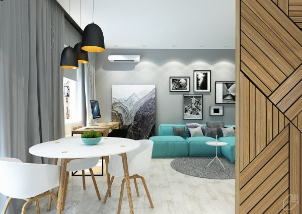 Artwork featuring mountains and open skies reinforce the airy atmosphere of the apartment no matter how compact