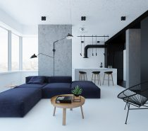 We love the light and dark contrast in this space, as well as the contrast of big the contrast of the thin black lines in the chair and lights with the big bold pieces like the couch and the black accent wall.