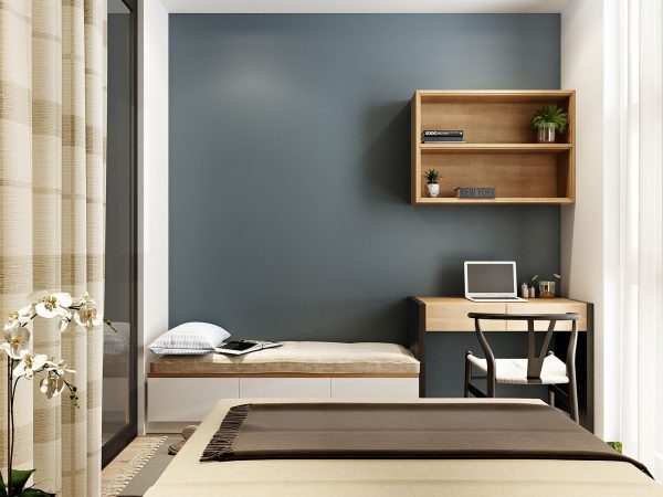 This blue gray wall is a wonderful accent to the warm brown color pallet reflected in the rest of the room you might think a dark color like this would