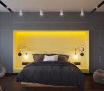 Check out this super bright design! The forms seem to retain a strong minimalist element, but the bright yellow headboard area pops out from the greyscale surroundings and definitely pushes this space more toward the side of futurism. High-end furniture and lighting makes a strong statement with their sculptural forms.