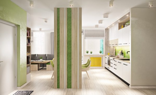 One of the bolder details is this mossy vertical garden wedged into this central wall its actually a housing to contain the refrigerator but becomes a