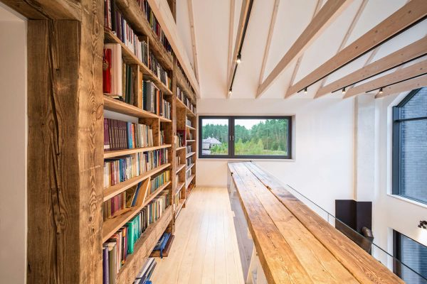 The forest with old oak panelling from a poznan townhouse new and old wood oscillate against a glass safety panel and wide glazed windows