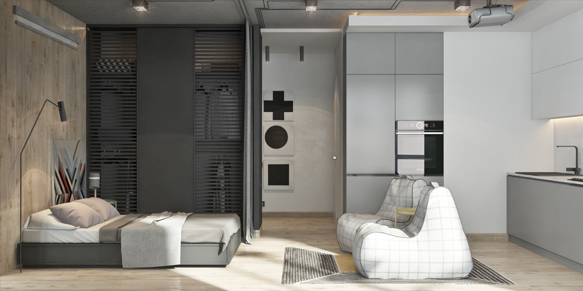 This monochromatic studio apartment is where function meets fashion all in this one room is where you will find the bedroom closet living and kitchen