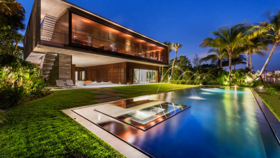 A luxury miami beach home with pools natural lagoons and a rooftop garden