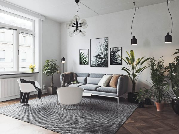 The use of indoor house plants in the main living area is anything but minimalist but it works to create a welcoming gathering spot