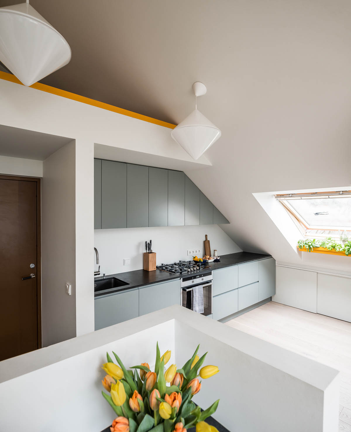 Go Black Or White In These Two Sloped Ceiling Apartments