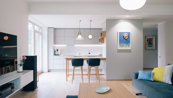 Minimalist home with blue and yellow accents 10 stunning apartments that show off the beauty of nordic interior design
