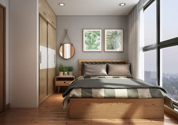 A botanical theme continues in the bedroom with wall art and live potted plants the bedcovers have a muted green stripe to tie in with natures palette