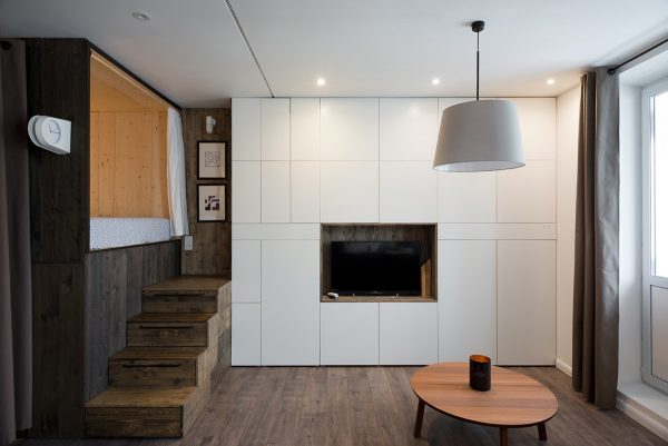 In order to allow this space a double bed was built into a custom lofted box in one corner of the open plan living area