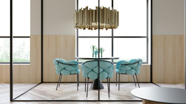 Matching its shape colour and size a round black coffee table in the living room is a shorter version of the dining room table