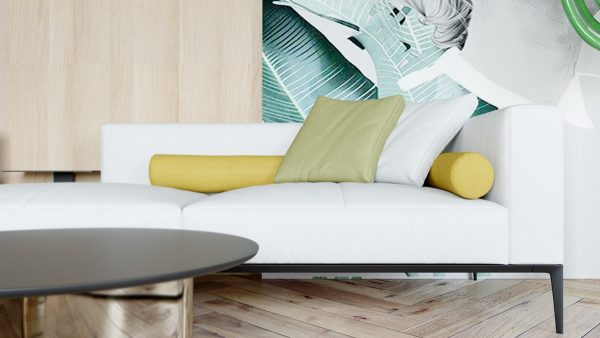 A contemporary white leather sofa with an elegant black frame is scattered with yellow and green accent cushions