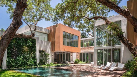 Shiny New Miami Mansion Under A Canopy Of Oak Trees