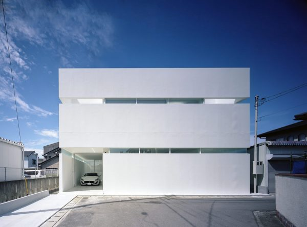 A Modern Minimalist House That Showcases A Maserati